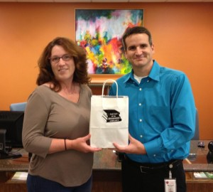Shannon being presented with the Nexus 7 bundle by Brunswick Branch Administator Michael Carlson.